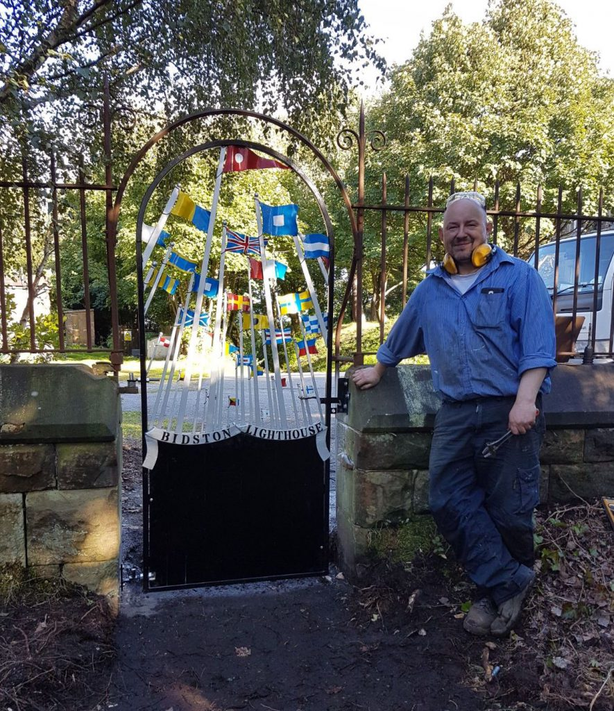 Blacksmith Alex Price by the newly installed gate to Bidston Lighthouse, on 15th September.