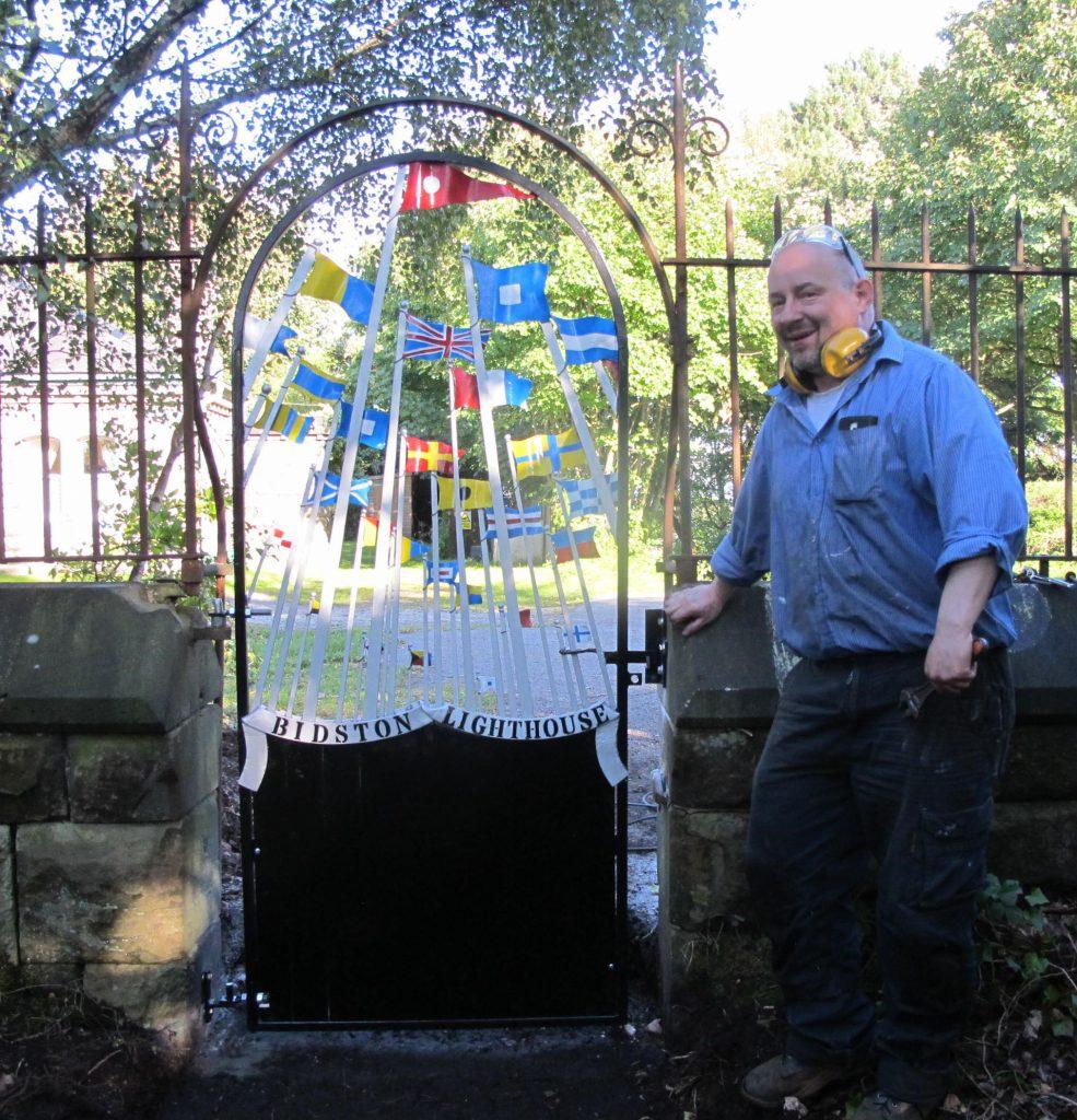Blacksmith Alex Price by the new gate to Bidston Lighthouse, 15 Sep.